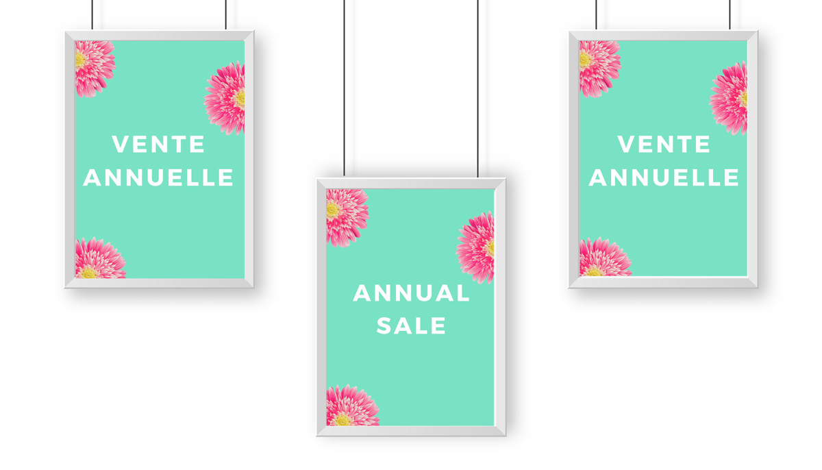 Photo: An example with two signs saying 'Vente Annuelle' with a sign in the middle hanging lower saying 'Annual Sale'